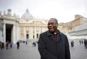 (Cardinal John Onaiyekan of Nigeria walks through Saint Peter's Square at the Vatican March 9, 2013. REUTERS/Dylan Martinez)